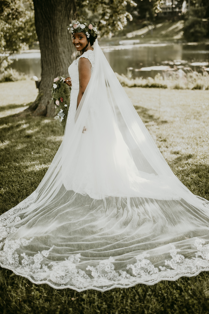 bride wearing lace wedding dress at rustic outdoor wedding