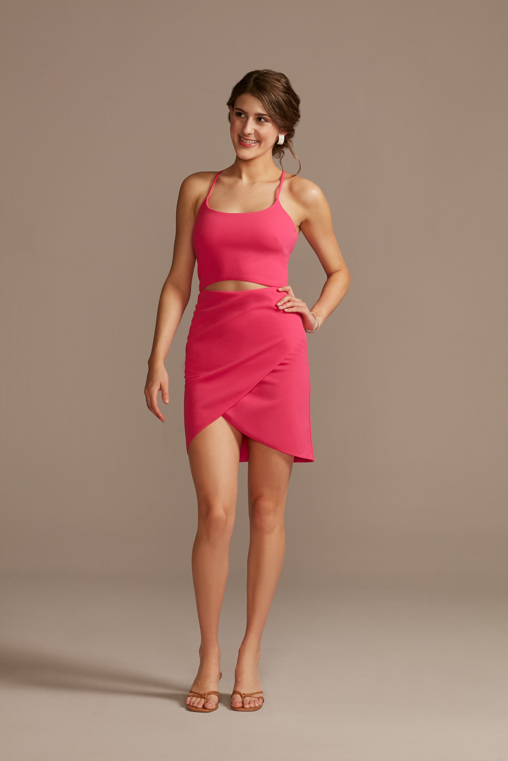 teen girl wearing hot pink mini dress with stomach cutout as a homecoming dress ideas