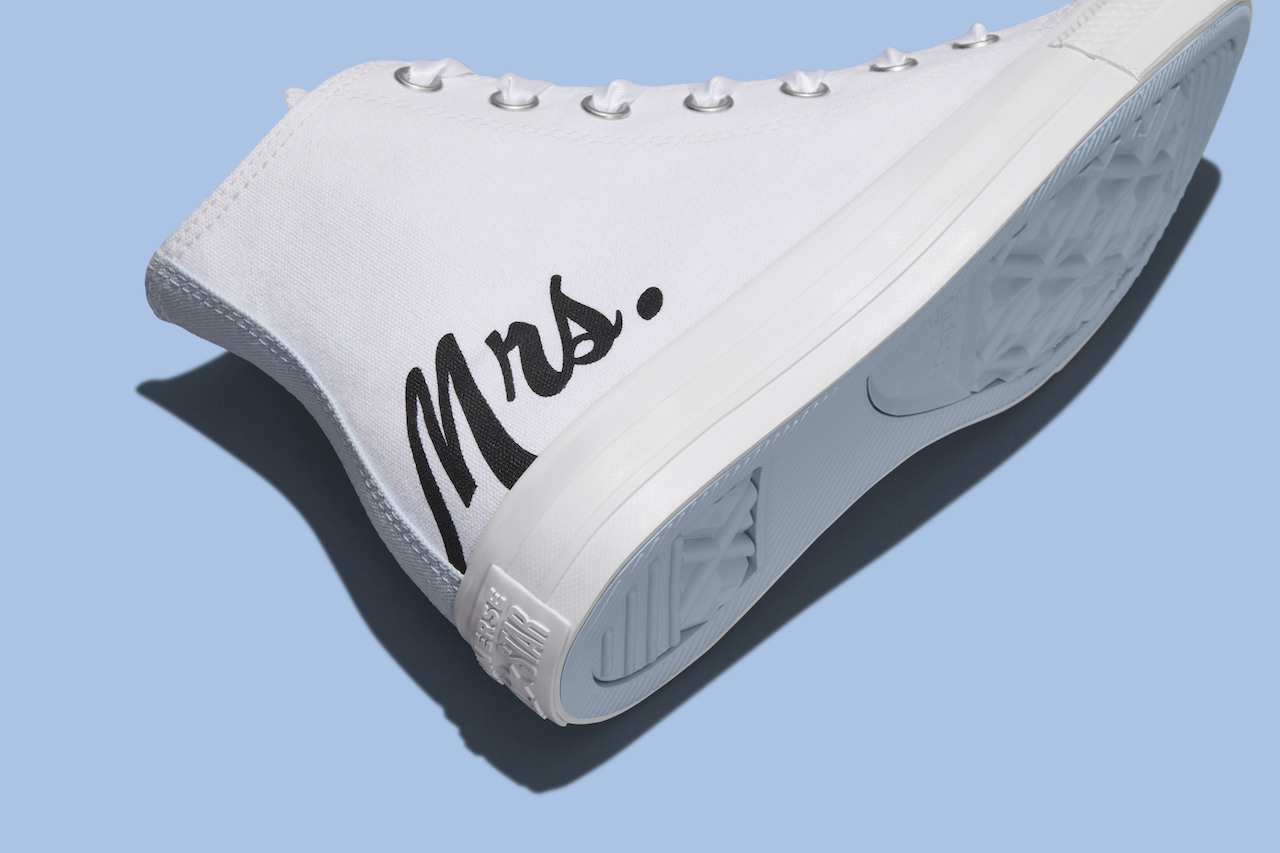 """white pair of custom wedding shoes with the writing """"mrs."""""""